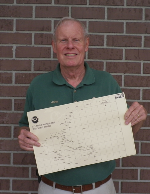 John Whisenant with hurricane tracking map